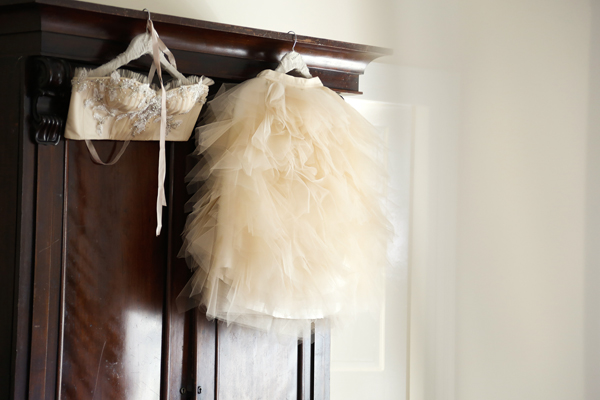 wedding skirt and corset hanging on a wardrobe