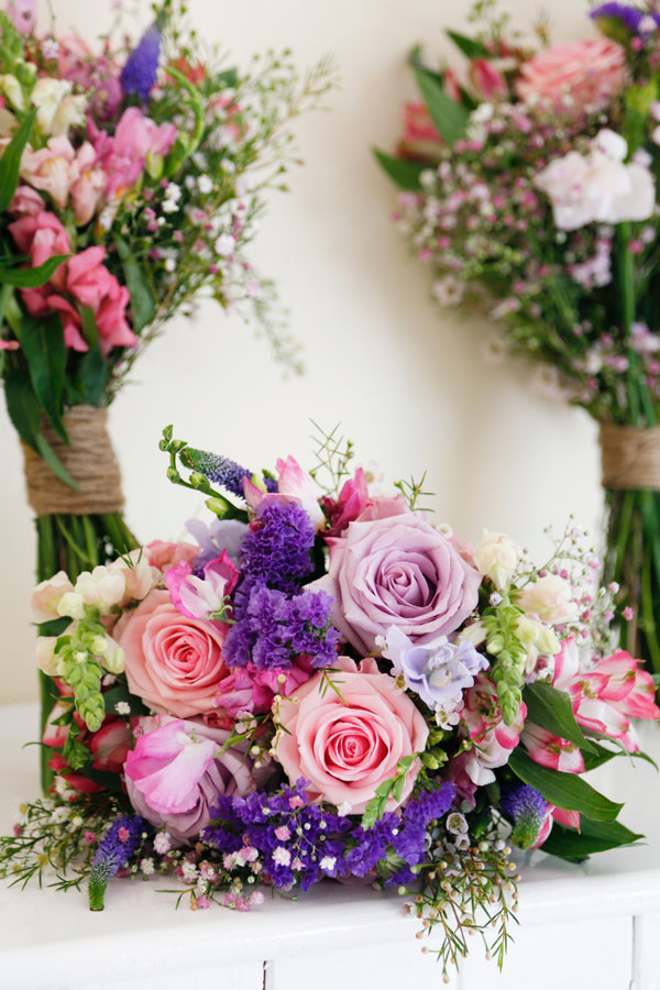 Colour photograph of a pink and purple wild flower wedding bouquet