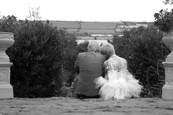 bride and groom sit on steps
