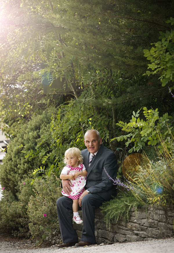 Granddad with child on his lap at wedding