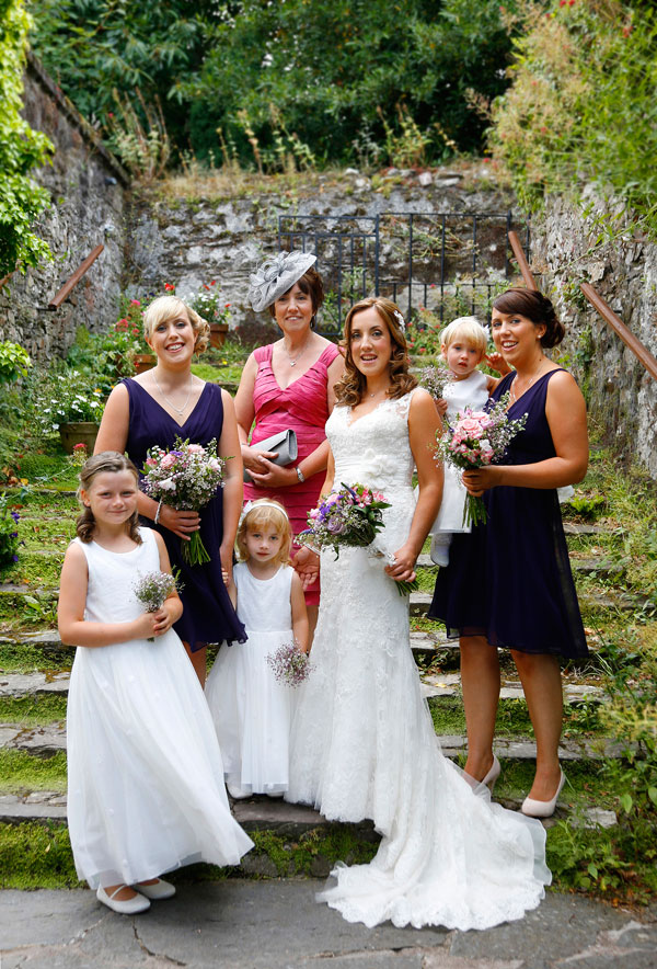 Colour photograph of a bride with her brides maids and mum at Barnabrow